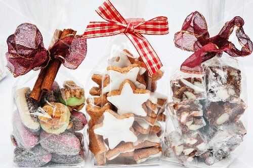 Three cellophane bags of Christmas gifts (cinnamon stars, Rocky Road and dates with marzipan)