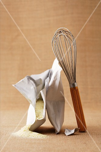 A bag of instant mashed potatoes with a whisk