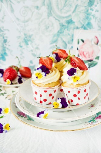Strawberry cupcakes decorated with tufted pansies