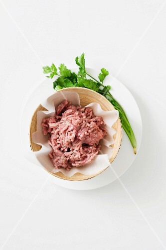 Minced pork in a paper-lined bowl