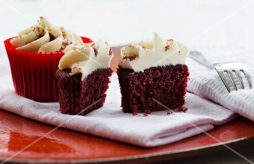 Red Velvet cupcakes topped with a light cream