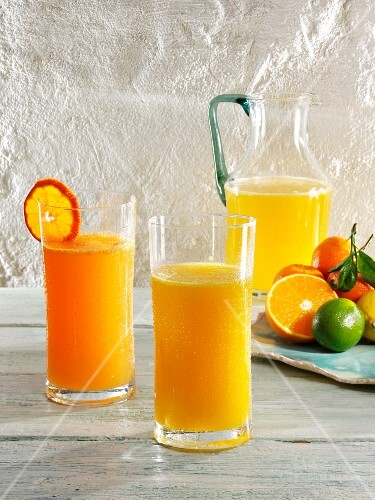 Various glasses of lemonade (mandarin, mandarin & orange, and orange)