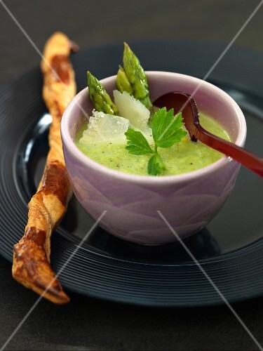 Green asparagus soup with Parmesan and a puff pastry stick
