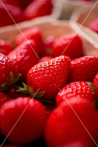 Fresh strawberries in a paper punnet (close-up)