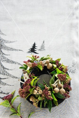 A Christmas wreath made from shimeji mushrooms and viburnum