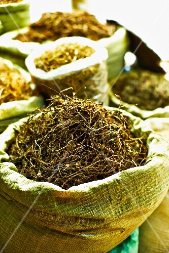 Sacks of dried herbs at a market in Saigon (Vietnam)