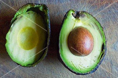 A halved avocado with stone