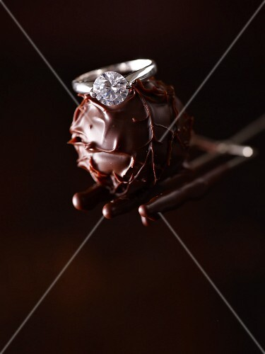A diamond ring on a chocolate truffle