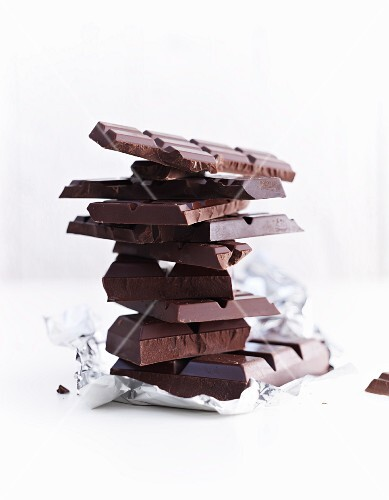 A stack of chocolate pieces on silver foil