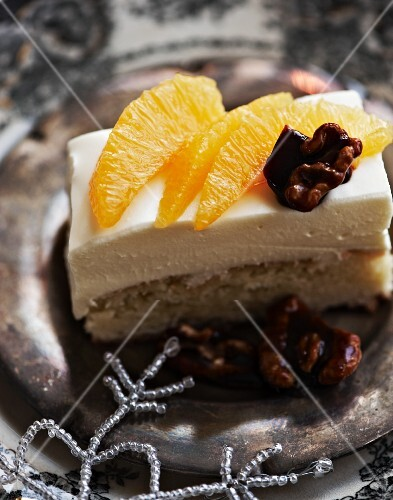 An orange cake slice with candied walnuts for New Year's Eve