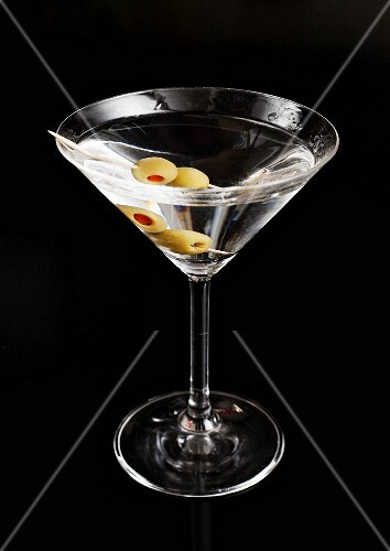 A martini against a black background
