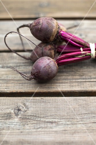 A bunch of beetroot on a wooden table