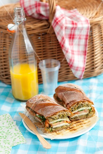 A ciabatta sandwich with tomatoes, mozzarella and pesto
