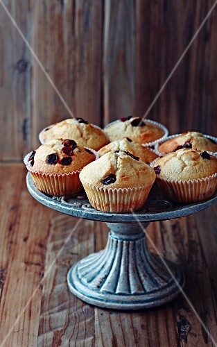 Muffins with dried cranberries on a cake stand