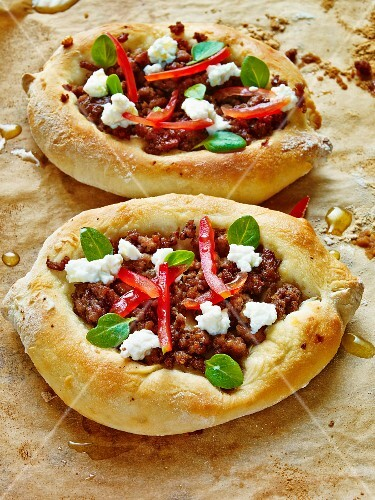 Minced lamb and feta cheese pizzas