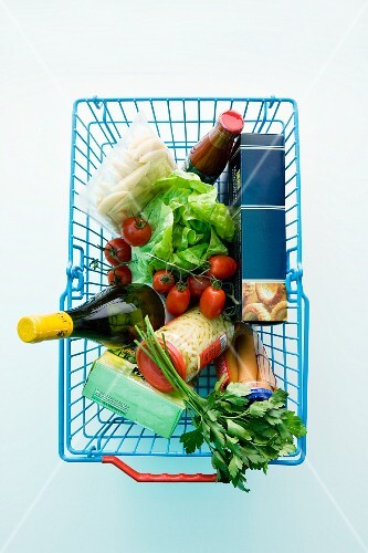 Assorted foodstuffs in a shopping basket
