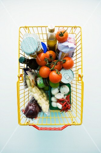 Vegetables and other groceries in a shopping basket