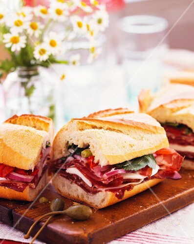 A submarine sandwich with salami and ham
