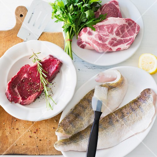Beef steak, pork collar steaks and fresh fish fillets for a barbecue