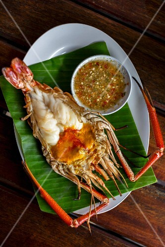 A grilled giant freshwater prawn with a dip (Ayutthaya, Thailand)