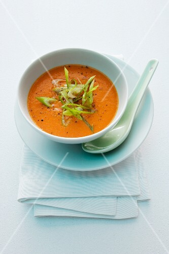Tomato and coconut soup with spring onions