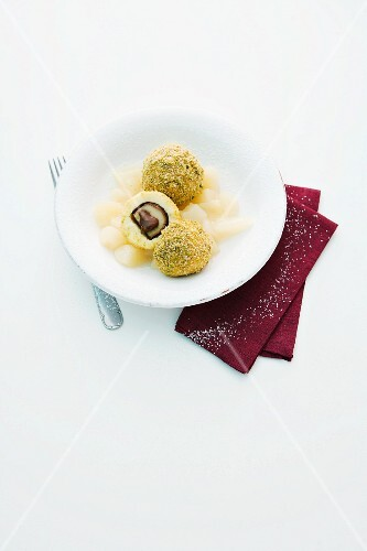Mozart dumplings on pear compote