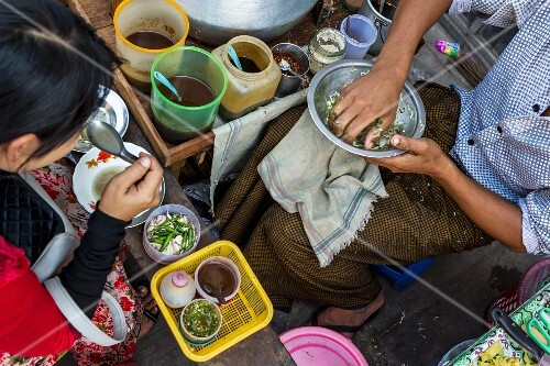 A noodle restaurant at a market in Myanmar