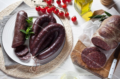 An arrangement of various different black puddings