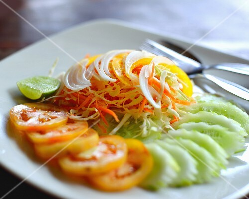 Vegetable salad with tomatoes, cucumber and grated carrots