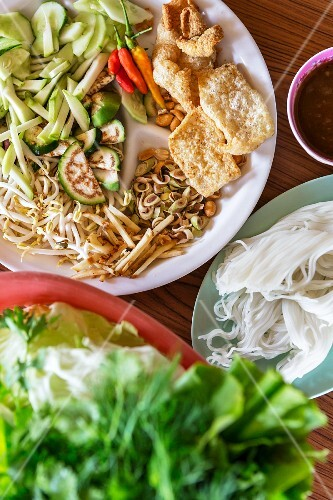 Accompaniments for grilled fish: orzo pasta, vegetables and salad (Vientiane, Laos)