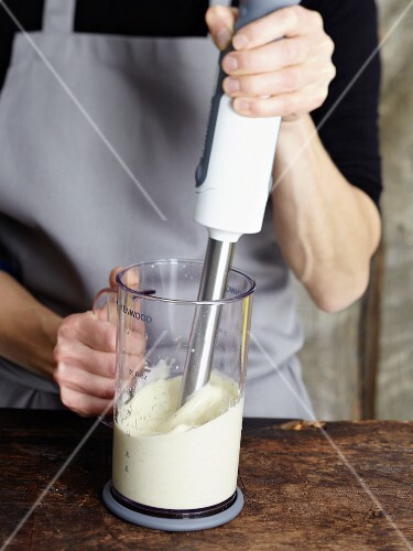 Dressing being whipped with a hand mixer
