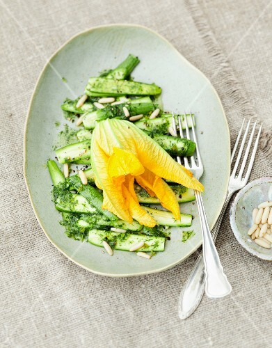 Courgette carpaccio with a courgette flower and mint