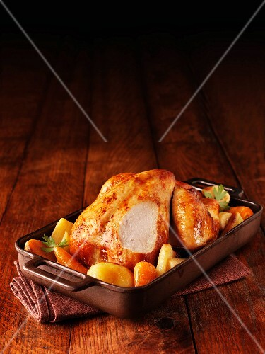 Roast chicken with parsnips and carrots