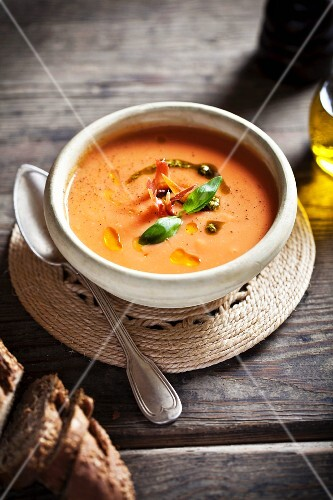 Tomato soup with pesto and basil