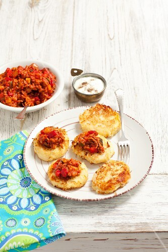 Potato and sauerkraut cakes with minced meat sauce