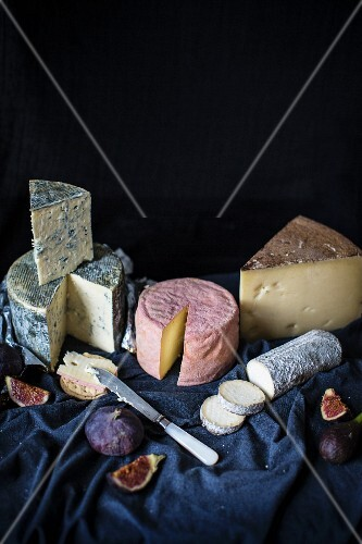 A selection of cheeses with figs