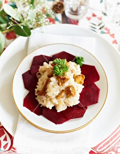 Chanterelle mushroom risotto on slices of beetroot