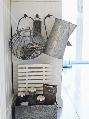 Wire baskets, zinc jug, bottles and old kitchen utensils