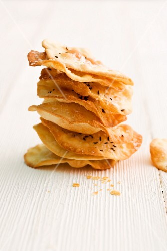 A stack of thin mini unleavened caraway bread