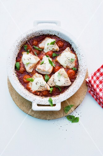 Turkey with tomatoes, mozzarella and basil