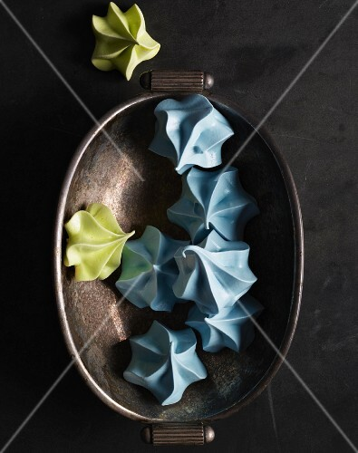 Blue and green meringues in metal dish
