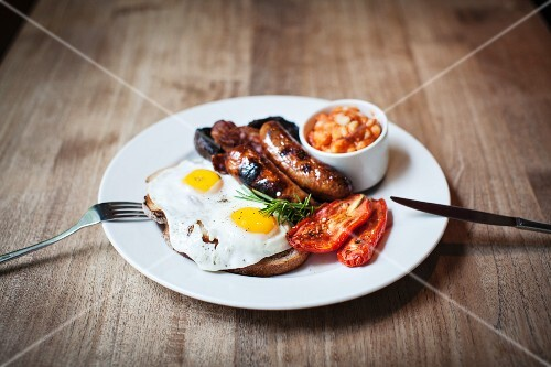 A English breakfast with sausages, fried eggs and beans