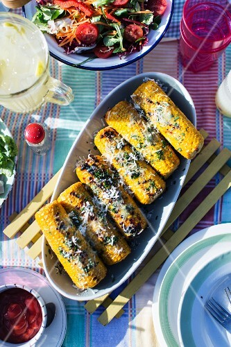 Grilled corn on the cob with herbs and cheese