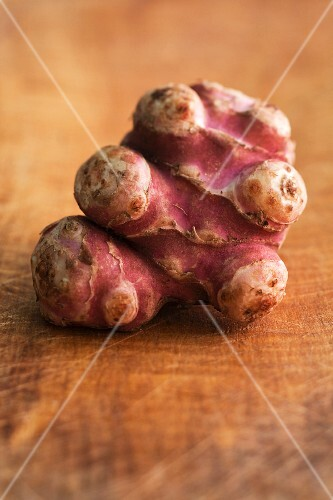 Jerusalem artichokes on wooden background