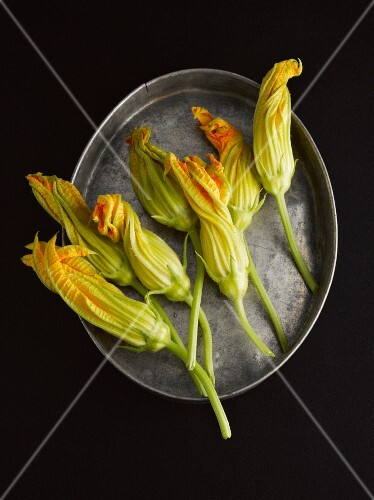 Courgette flowers on a metal tray