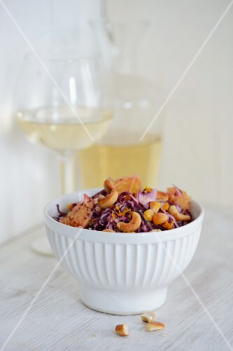 Red cabbage salad with orange and cashew nuts