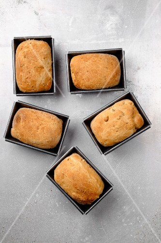 Mini loaves of malt bread in tins