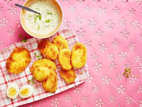 Breaded kohlrabi escalopes with a dip