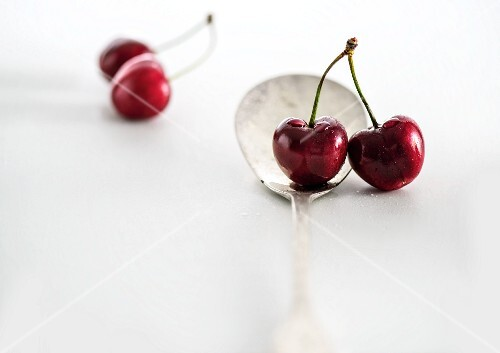 Pairs of cherries with a spoon