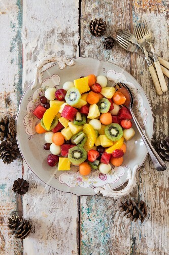 Fruit salad with melon, strawberries, kiwi, grapes, pineapple, orange and watermelon